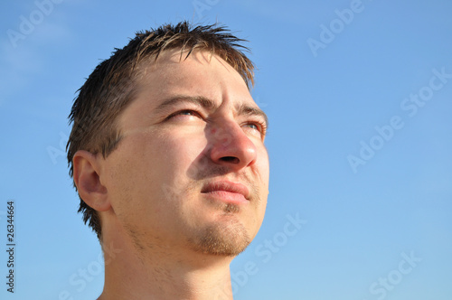 A young man lost in thought looking away, portrait,