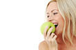 woman eat green apple
