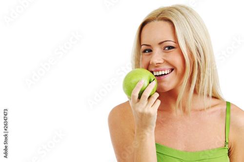 woman eat green apple - 26347473