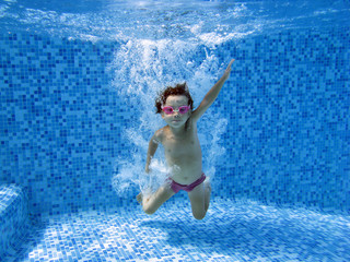 Underwater child after jumping to the swimming pool