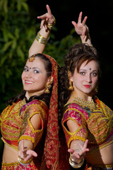 two young woman dance - indian cloth
