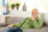 Portrait of pensioner on couch poster