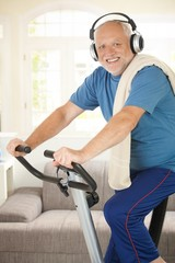 Sporty senior listening to music while exercising