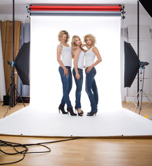 three models in photographer studio