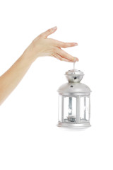 Hand holding lantern in white background