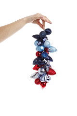 Hand holding christmas ornaments in white background