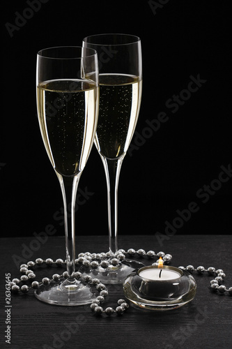 Glasses of champagne with black background with christmas decora