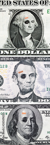US currency with black eyes and band aid