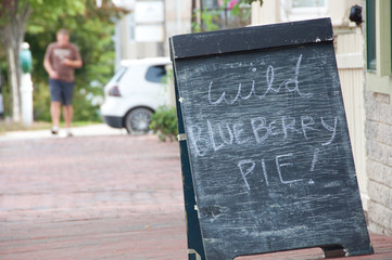 Chalkboard Sign Advertising Wild Blueberry Pie For Sale
