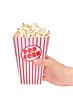 Hand holding a full popcorn box