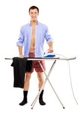 Full length portrait of a man ironing