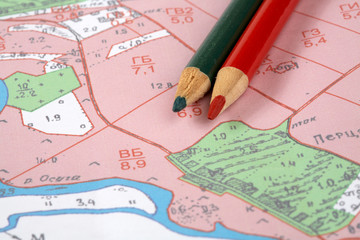 Topographic map and  pencils