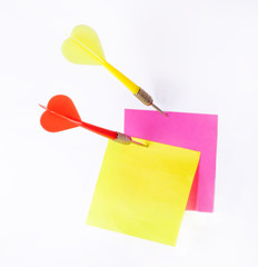 Darts and notes isolated on a white background.