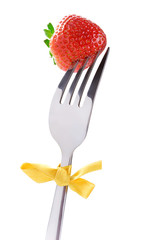 Fruit diet: strawberry on a fork, isolated on white