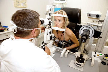 Doctor,examining a patient in ophthalmology clinic