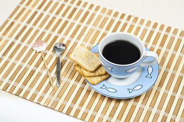 A cup of coffee on the bamboo mat