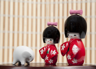 Small Japanese dolls and small elephant