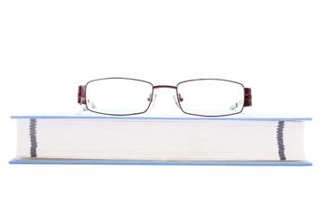 Eyeglasses on the blue book