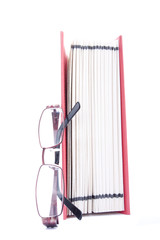 Red open book and eyeglasses