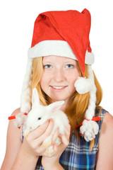girl  in santa hat with rabbit