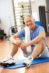Man Resting After Exercises In Gym