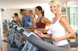 Senior Woman On Running Machine In Gym