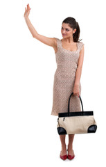 young smiling woman with bag waving hello