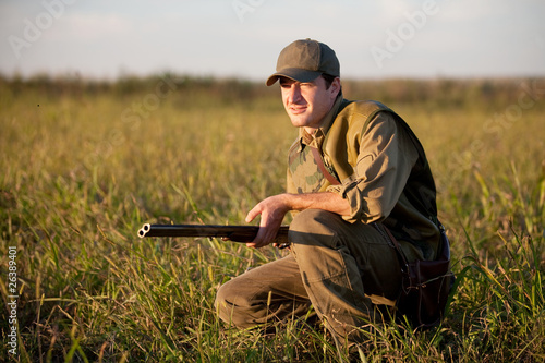 Hunter waiting sliently on the hunting field