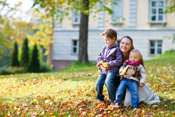 Mother and kids at autumn park