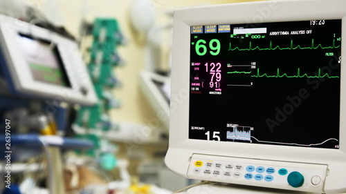 ICU monitor with patient on bacground