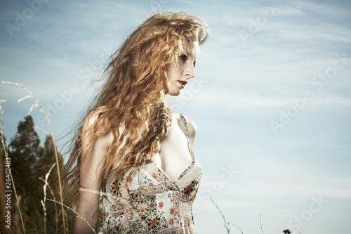 Portrait of the beautiful woman against the sky