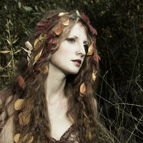 Portrait of the beautiful woman in wood