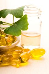 ginko biloba essential oil with fresh leaves - beauty treatment