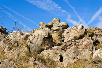 Boulders of fantastic shapes on a blue sky