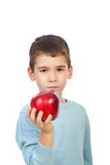 Preschool boy holding red apple