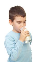 Child boy drinking milk