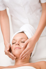 Luxury care - woman at face massage