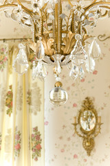 chandelier and sconce on the wall