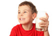 little boy in sports shirt laughs and holds container of milk