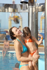 woman with daughter are taking shower on cruise ship