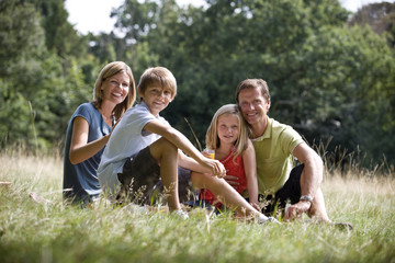 A family sitting together on the grass