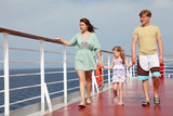 family with daughter walking on cruise liner deck, full body
