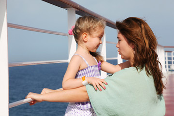 mother and daughter speaking on cruise liner deck