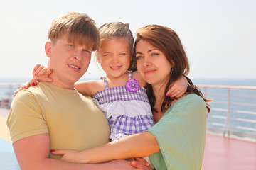 happy family with daughter on cruise liner deck