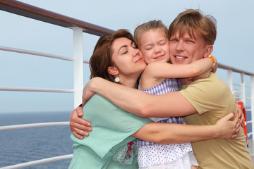 family with daughter on cruise liner deck