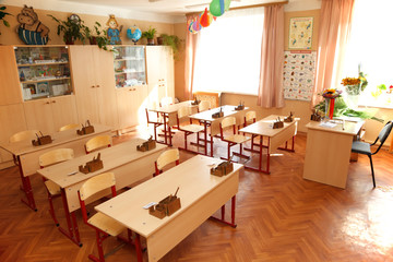 Empty classroom ready for lessons. Interior school.