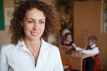 Portrait of schoolteacher in a white blouse in school.