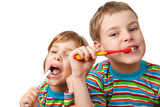 Fototapety Brother and sister in same shirts brush their teeth on white