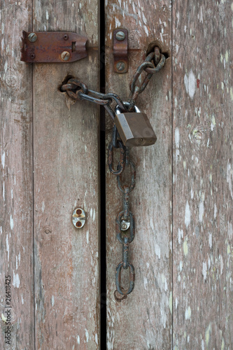 Old chain and padlock vertical