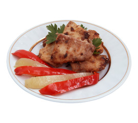 Fried fish  with vegetables on plate isolated